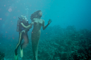 Rick Ciordia touching a mermaid
